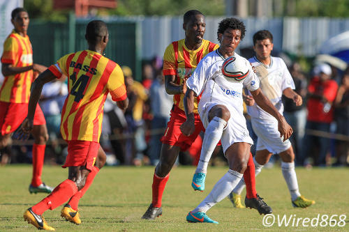 Photo: W Connection forward Juma Clarence holds off Point Fortin Civic defender Lyndon Diaz (centre) while teammate Bevon Bass (left) runs in to help. (Courtesy Allan V. Crane/Wired868)