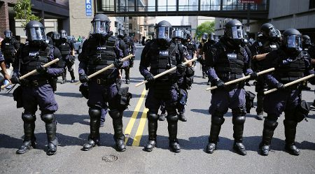 Photo: The police get ready for some restrained service.
