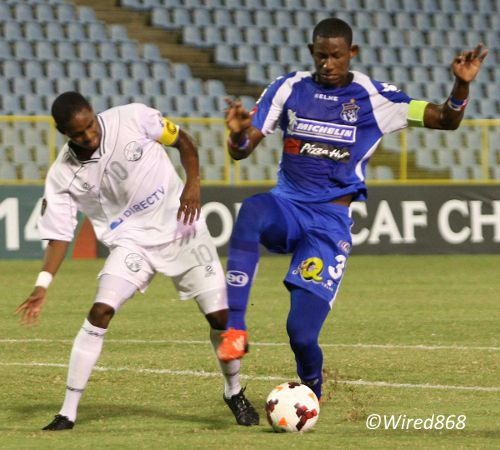 Photo: W Connection captain Joevin Jones (left) has his path to goal blocked by Arabe Unido captain Fidel Caesar. (Courtesy Wired868)