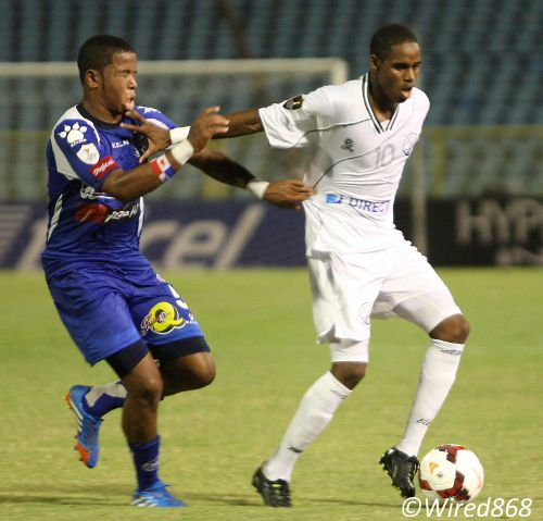 Photo: W Connection midfielder Joevin Jones (right) holds off Arabe Unido midfielder Paul Roderick during CONCACAF Champions League action last night in Port of Spain. (Courtesy Wired868)