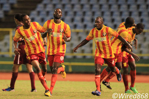 Photo: Point Fortin substitute Bevon Bass (second from left) celebrates the winning item against North East Stars with his teammates in Port of Spain. (Courtesy Allan V. Crane/Wired868)