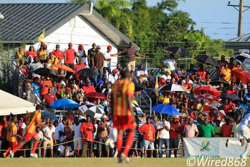 Photo: Point Fortin supporters offered a minute's silence for Akeem Adams during yesterday's First Citizens Cup match at Mahaica Oval yesterday. (Courtesy Allan V. Crane/Wired868)