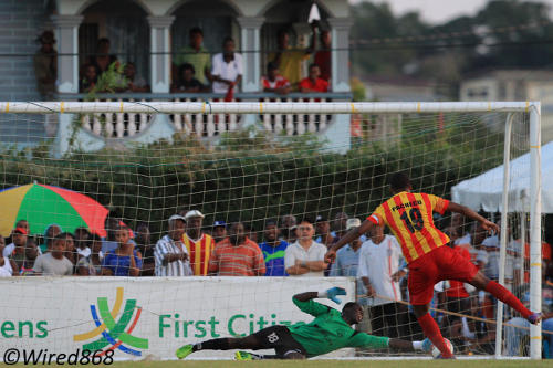 Photo: Point Fortin Civic player Andrei Pacheco's drives a penalty past W Connection goalkeeper Julani Archibald. (Courtesy Allan V. Crane/Wired868)