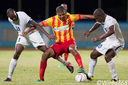 Photo: Point Fortin Civic attacker Andrei Pacheco (centre) holds off Police FC captain Todd Ryan (left) and Elijah Belgrave during their Pro League opener. Pacheco is one of ten ex-W Connection players used by Point Fortin this season. (Courtesy Allan V. Crane/Wired868)