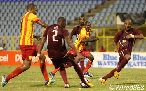Photo: North East Stars defence Kareem Moses (second from left) executes a clearance despite the best efforts of Point Fortin attacker Andrei Pacheco (far left). (Courtesy Wired868)