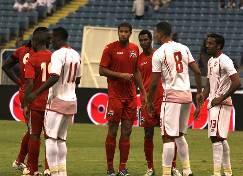 Photo: Trinidad and Tobago defender Radanfah Abu Bakr (centre) and midfielder Ataullah Guerra (second from right) brainstorm during international battle against the UAE. (Courtesy TTFA Media)