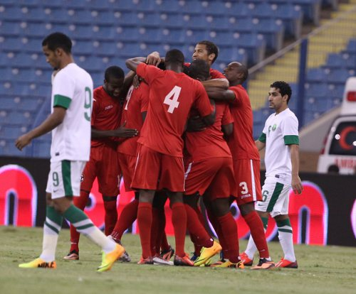 "Photo: The ""Soca Warriors"" celebrate one of three goals against Saudi Arabia during the OSN Cup. (Courtesy TTFA Media)"