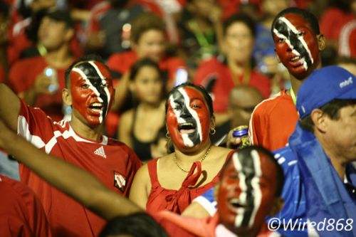 Photo: Trinidad and Tobago football fans get behind their team during the 2010 World Cup qualifying campaign. (Courtesy Wired868)