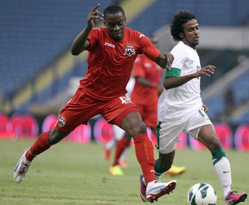 Photo: Trinidad and Tobago defender Robert Primus (left) in action against Saudi Arabia in 2013. (Courtesy TTFA Media)