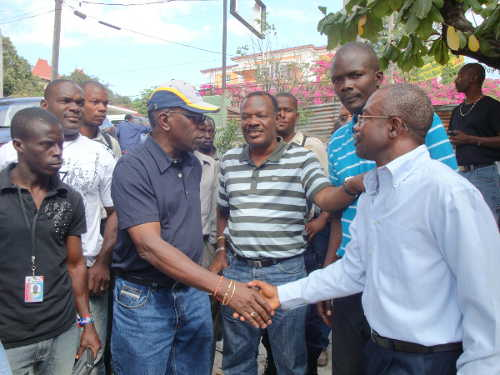 Photo: Then FIFA vice-president Jack Warner (centre) greets Jean Degraff (far right) who was buried under rubble for two days during the 2010 Port-au-Prince earthquake. Haitian football officials accused Warner of failing to relay millions in aid relief funds to the impoverished island. (Courtesy CONCACAF)