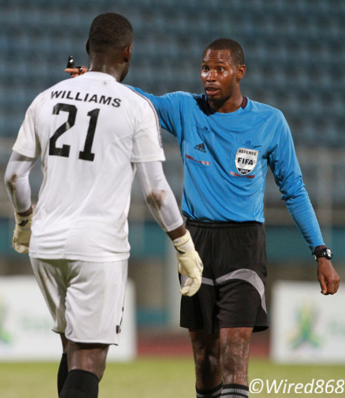 Photo: Referee Rodphin Harris (right) has a word with Central FC goalkeeper Jan-Michael Williams. (Courtesy Allan V. Crane/Wired868)
