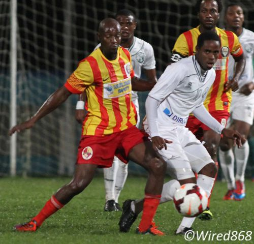 Photo: Point Fortin Civic midfielder and ex-Connection employee Nickcolson Thomas (left) kept close watch on Connection's Joevin Jones yesterday but could not stop him from deciding the match. (Courtesy Wired868)