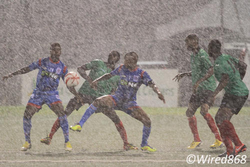Photo: St Ann's Rangers attackers Michael Yaw Darko (far left) and captain Clevon McFee (third from left) try to locate the ball in the downpour while three Jabloteh defenders keep watch. (Courtesy Allan V. Crane/Wired868)