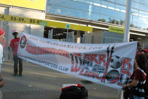 Photo: SWO founding member Nigel Myers (left) holds up a Warrior Nation banner in Dortmund during the 2006 World Cup.