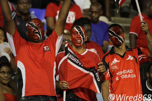 Photo: Some die-hard Trinidad and Tobago football fans get behind their team at the Hasely Crawford Stadium, Port of Spain. (Courtesy Wired868)