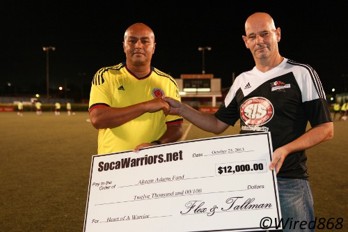 Photo: SWO member and Central FC operations director Kevin Harrison (right) presents a $12,000 cheque to Dion Sosa, the local manager for then ailing player Akeem Adams. (Courtesy Allan V. Crane/Wired868)