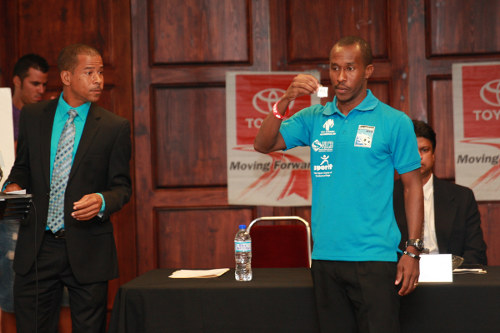 Photo: Caledonia AIA captain Stephan David (right) participates in the 2013 Toyota Classic draw while Pro League CEO Dexter Skeene looks on. (Courtesy TT Pro League)