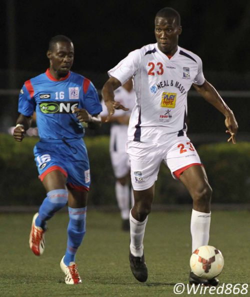 Photo: Caledonia AIA striker Jamal Gay (right) keeps the ball from St Ann's Rangers midfielder Kennedy Isles. Gay is joint second on the Pro League scoring charts. (Courtesy Wired868)