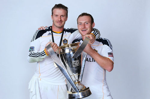 Photo: Chris Birchall (right) and former England superstar David Beckham pose with the 2011 MLS Cup. (Courtesy Jeff Gross/Getty Images)