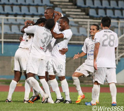 Photo: DIRECTV W Connection players celebrate during their 4-1 Toyota Classic win over Malabar FC at the Ato Boldon Stadium. (Courtesy Wired868)