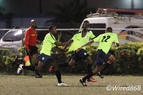 Photo: Malabar FC players try to get hold of Gorian Highley (centre) as he celebrates his hattrick during Toyota Classic action against San Juan Jabloteh. No one could catch Highley on the night. (Courtesy Allan V Crane/Wired868)