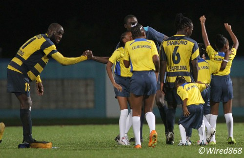 Photo: Club Sando captain Teba McKnight (far left) revels in his team's historic Toyota Classic semi-final win over Defence Force. (Courtesy Wired868)