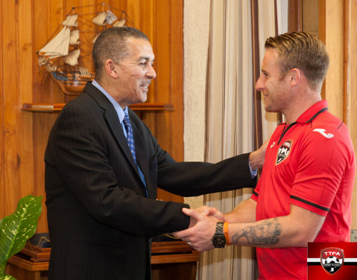 Photo: Soca Warrior Chris Birchall (right) meets Trinidad and Tobago president Anthony Carmona on the eve of his farewell match in Port of Spain in November 2013. (Courtesy TTFA Media)