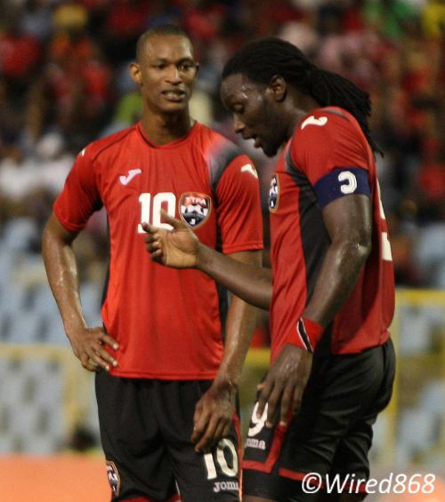 Photo: Trinidad and Tobago goal scorers Ataullah Guerra (left) and team captain Kenwyne Jones have a word during their dismantling of Jamaica. (Courtesy Wired868)