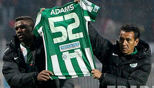 Photo: Former Ferencvarosi manager Ricardo Moniz (right) and a player pay tribute to Akeem Adams after the club's only win since the player's hospitalisation.