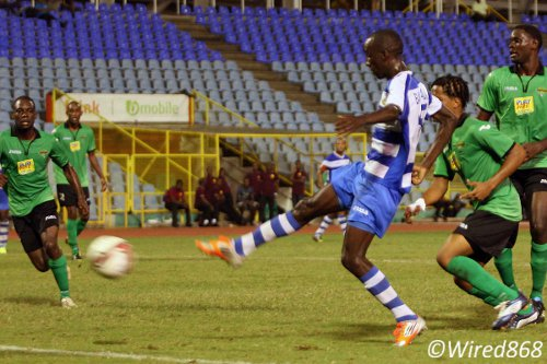 Photo: Defence Force midfielder Jerwyn Balthazar shoots for goal against San Juaj Jabloteh. (Courtesy Wired868)