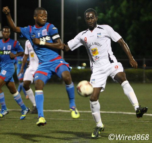 Photo: Former St Ann's Rangers captain Clevon McFee (left) and Caledonia AIA attacker Keyon Edwards compete for the ball. McFee is due to return to the Police line-up against W Connection tomorrow. (Courtesy Wired868)