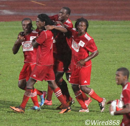 Photo: Central FC players celebrate after their semifinal penalty shootout win over Malabar FC. (Courtesy Wired868)