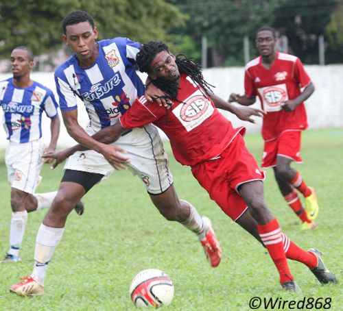 Photo: Central FC midfielder Jason Marcano (right) battles with St Mary's College captain Myles Yorke during the TTFA FA Trophy round of 16. (Courtesy Wired868)