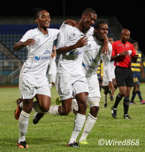 Photo: Hashim Arcia (centre) celebrates W Connection's opener against Club Sando along with teammates Neil Benjamin (left) and Joevin Jones. (Courtesy Wired868)