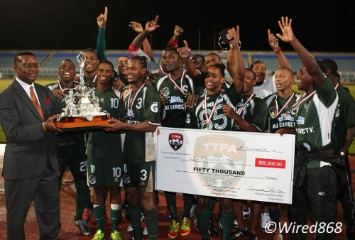 Photo: DIRECTV W Connection celebrates lifting the 2013 TTFA FA Trophy title. (Courtesy Wired868)