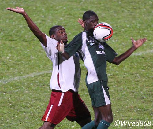 Photo: W Connection attacker Jem Gordon (right) controls on his chest despite the close attention of North East Stars defender Kareem Moses. (Courtesy Wired868)