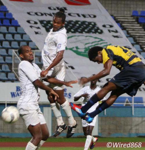 Photo: Club Sando attacker Devon Modeste (right) powers a header past Connection players Gerard Williams (centre) and Joel Russell. But he could not beat Connection goalkeeper Julani Archibald (not in the picture). (Courtesy Wired868)