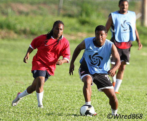 Photo: TTFA technical director Anton Corneal (centre) enjoys some playing time during the 2013 Wired868 Football Festival. (Courtesy Allan V Crane/Wired868)