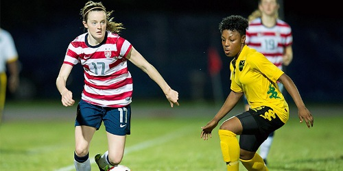 Photo: United States midfielder Rose Lavelle (left) takes on a Jamaican defender during the present CONCACAF competition. The US will face Trinidad and Tobago next. (Courtesy MexSport/CONCACAF)