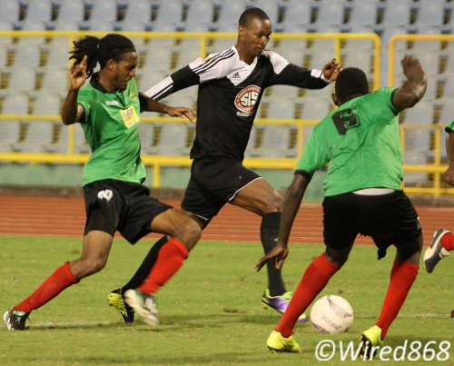 Photo: Central FC's new signing Ataullah Guerra (centre) tries to find a way past San Juan Jabloteh players Dwayne James (left) and Dario Holmes. (Courtesy Wired868)