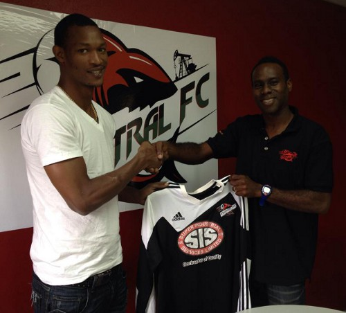 Photo: Trinidad and Tobago international midfield ace Ataullah Guerra (left) receives a Central FC jersey from assistant coach Kevin Jeffrey. (Courtesy Central FC)