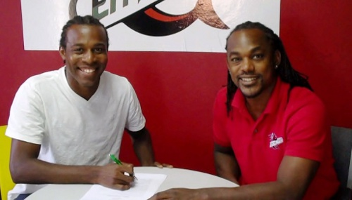 Photo: Yohance Marshall (left) officially agrees terms with Central FC CEO Brent Sancho. (Courtesy Central FC)