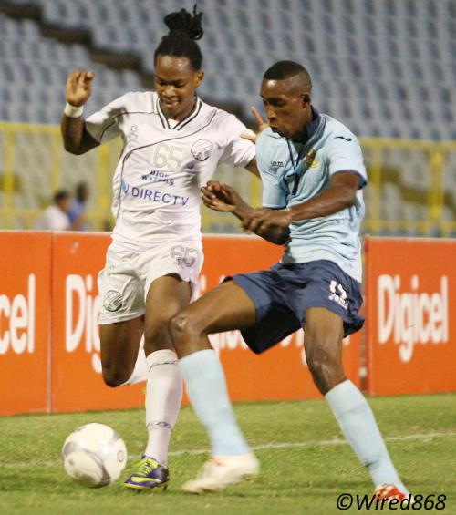 Photo: W Connection attacker Neil Benjamin Jr (left) gave makeshift Defence Force left back Ross Russell Jr a testing time last night. (Courtesy Wired868)
