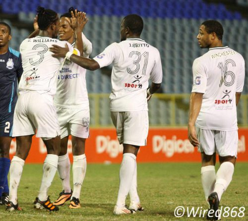 Photo: W Connection captain Gerard Williams (far left) is congratulated by teammates Neil Benjamin (second from left), Jerrel Britto (second from right) and Shahdon Winchester. (Courtesy Wired868)