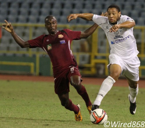 Photo: DIRECTV W Connection attacker Shahdon Winchester (right) beats North East Stars midfielder Keron Cummings to the ball. (Courtesy Wired868)