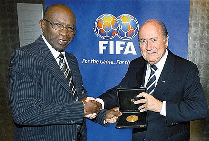 Photo: Ex-FIFA VP Jack Warner (left) was always fond of taking gifts from FIFA president Sepp Blatter. Can Gary Griffith tell us if thief from thief is categorised as robbery?