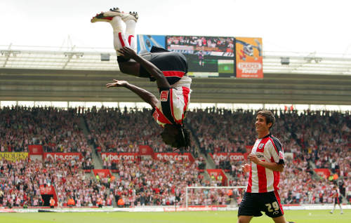 Photo: Kenwyne Jones jumps for joy during his spell at Southampton. (Courtesy Ian Walton/Getty Images)