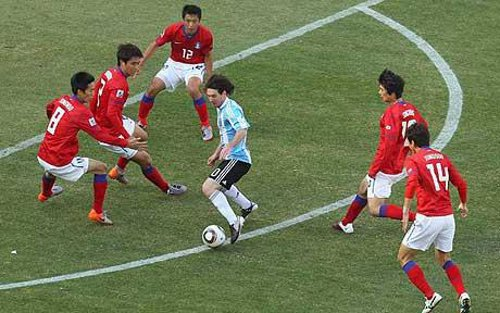 Photo: Argentina star Lionel Messi (centre) takes on the entire Republic of Korea defence during the 2010 World Cup. (Courtesy Telegraph.co.uk)