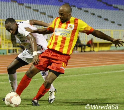 Photo: Point Fortin forward Kendell Davis (right) escapes Caledonia AIA utility player Noel Williams. (Courtesy Wired868)