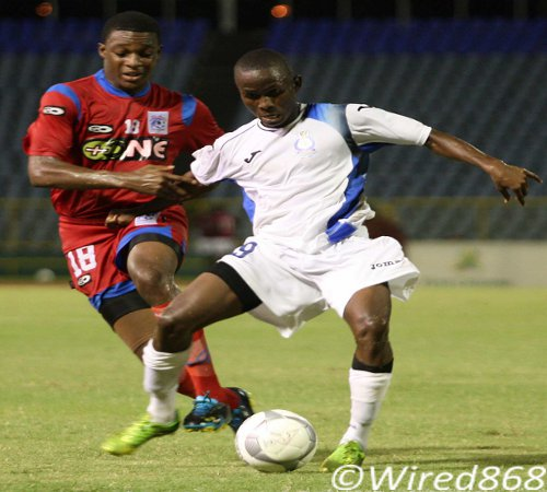 Photo: Promising Police FC teenager Joel Lewis (right) attempts a pass while being harrassed by St Ann's Rangers defender Jemel Berot. Lewis, who is not a policeman, will be sweating over whether Police FC will be permitted to continue in the Pro League. (Courtesy Wired868)
